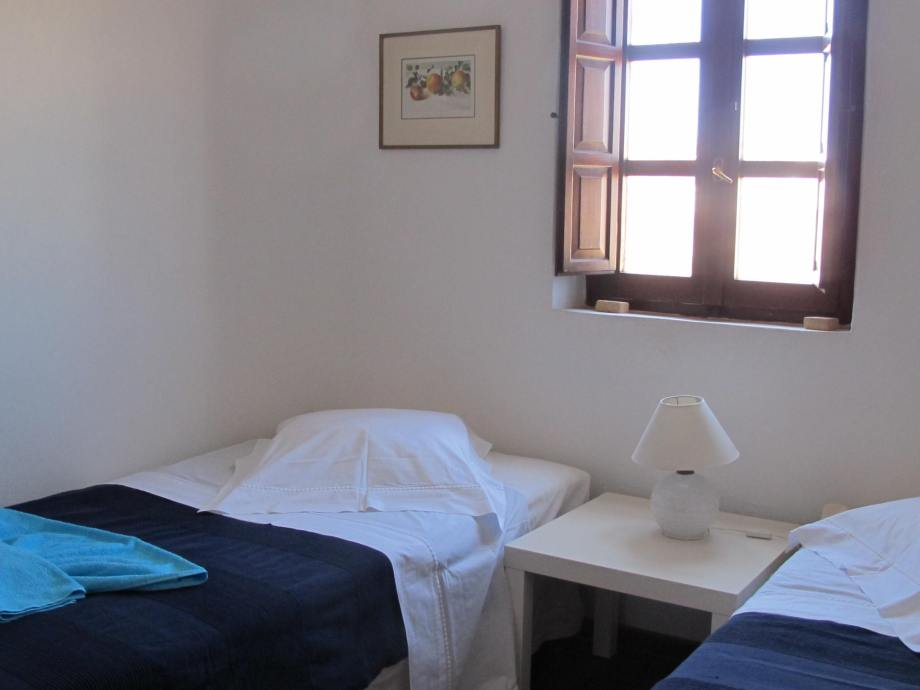 The 1st floor bedroom is fitted with two single beds
