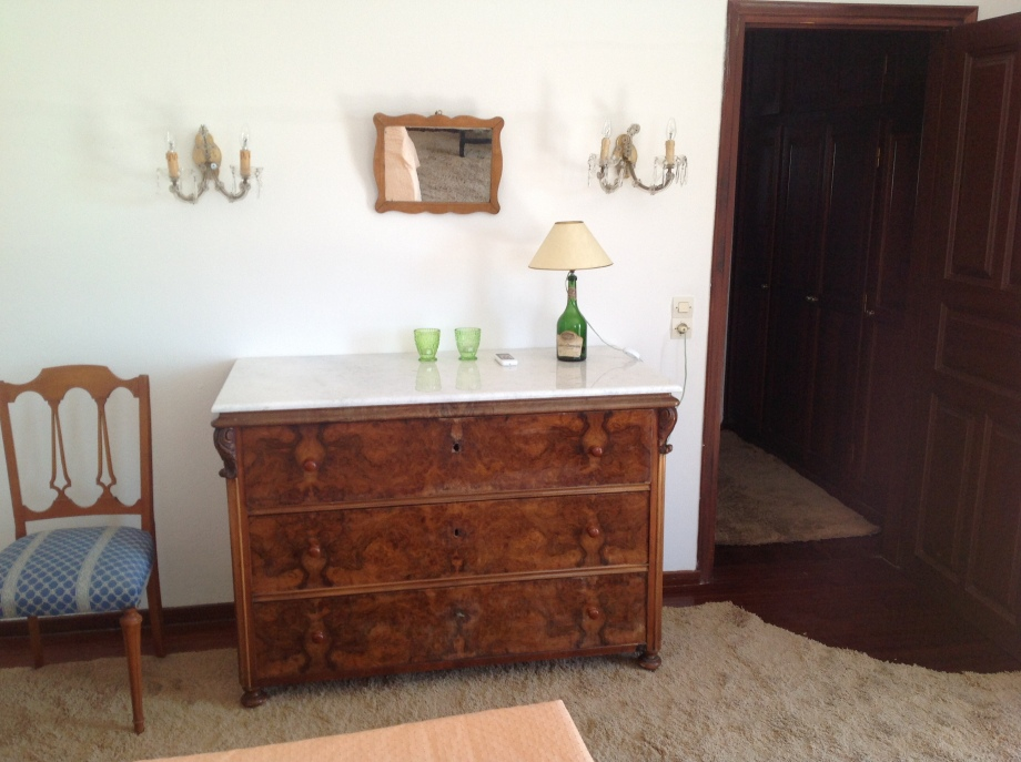 Partial view of the master bedroom showing antique chest of drawers