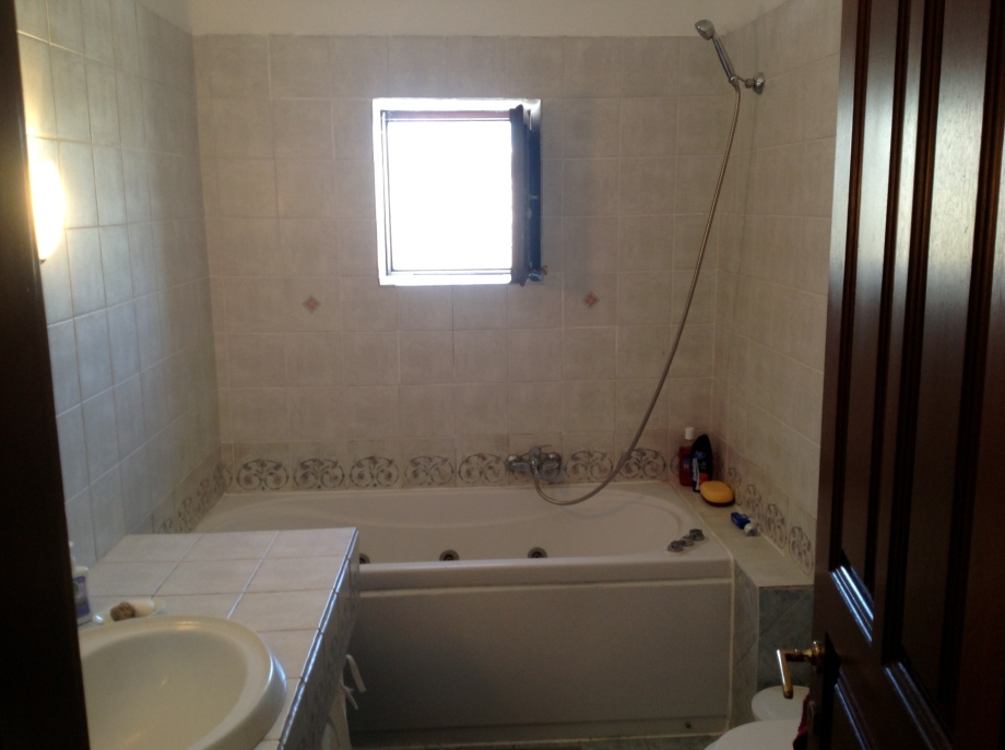 Adjacent to the master bedroom is a spacious bathroom with a washing machine