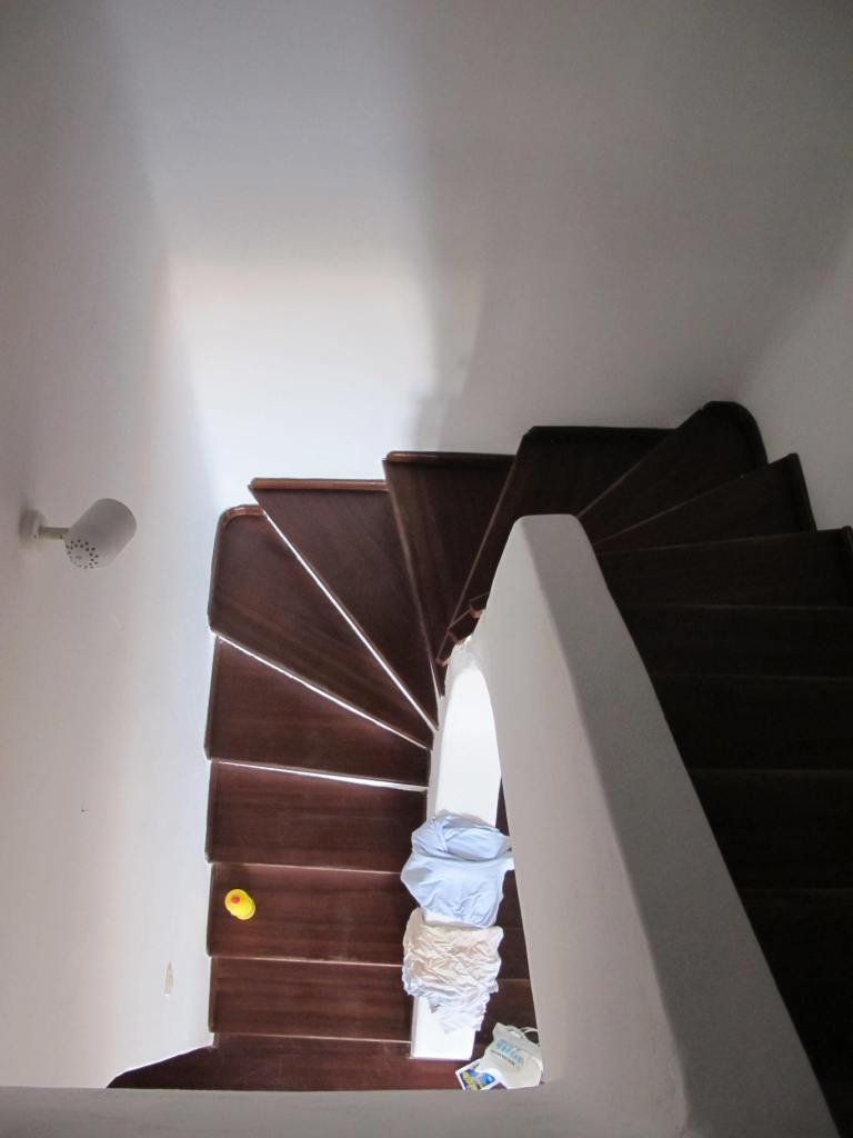The stairway leading to the 1st floor